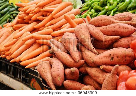 Sweet Potato And Carrot On Market Stand