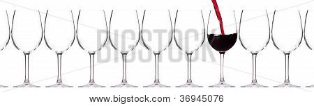 Full And Empty Glass Of Red Wine