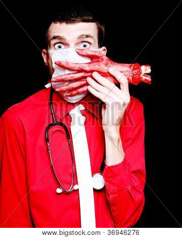 Doctor Death Surgeon Holding Sawn Off Human Hand