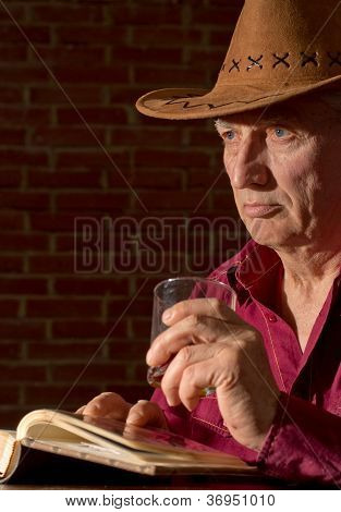 Caucasian old man with a nice glass sitting