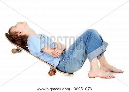 Boy lying on a skateboard