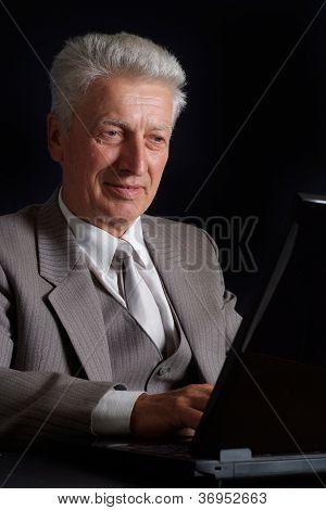 Glad elderly man in suit