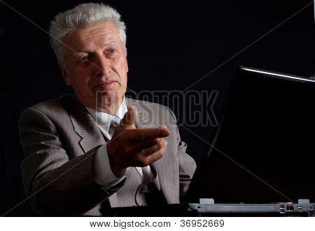 Imposing old man in suit