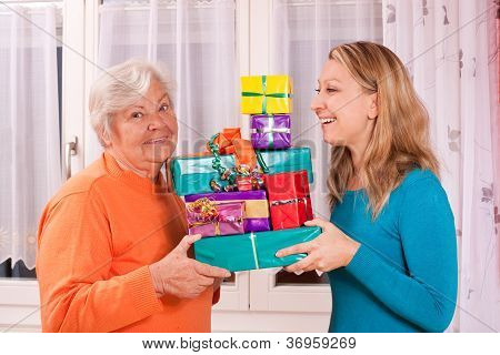 Old And Young Woman Holding Gifts