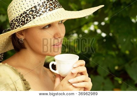 Happy woman sitting on the veranda