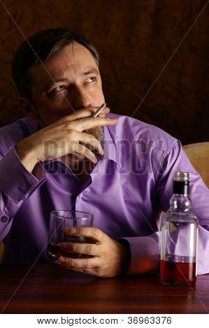 guy drinking and smoking