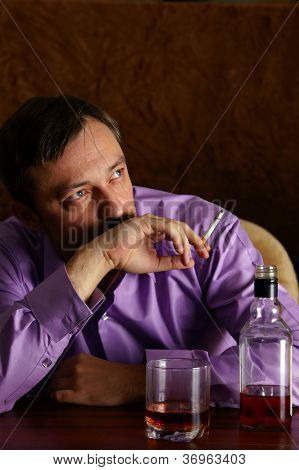 man with whiskey and cigarette