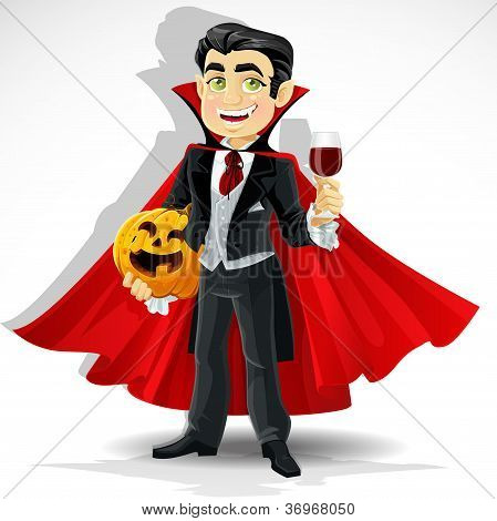 Charming vampire with Halloween pumpkin and a glass of blood