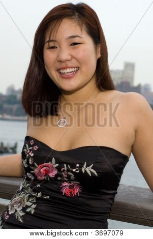 Asian Woman Going To Wedding Overlooking River