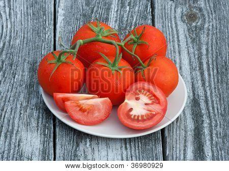 Vine Tomatoes On Old Wood Background