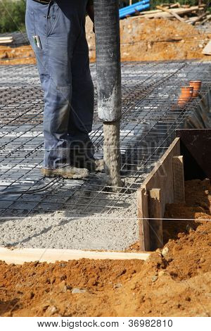 Builder Pouring Concrete Foundations