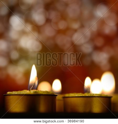 Golden Burning Candles