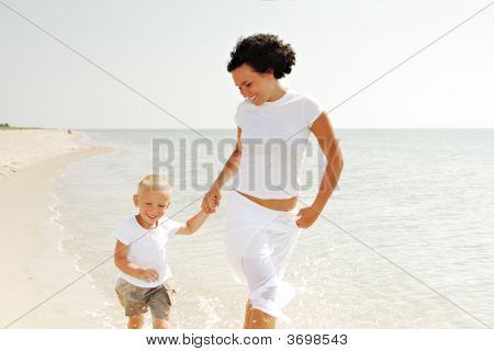 Mother And Child On Beach