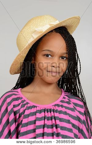 Young african girl wearing a straw hat
