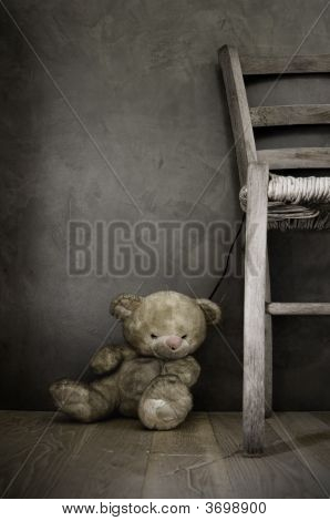 Old Teddy Bear Toy And Chair