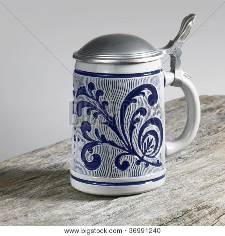 Blue Decorated Stein On Wooden Surface
