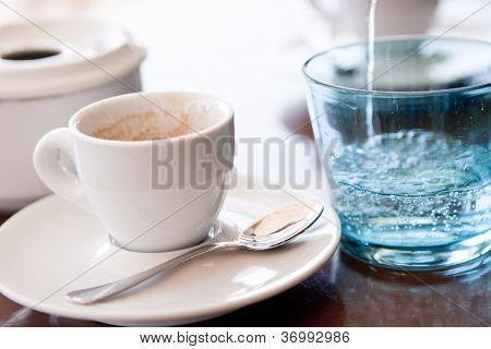 Hot Aromatic Espresso Cup And Cold Water In Glass