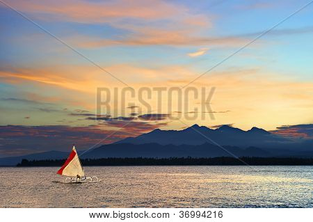 Local Outrigger Sailing Boat In A Tropical Sea