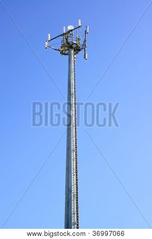 Telecommunications Tower. Mobile Phone Station In A Blue Sky