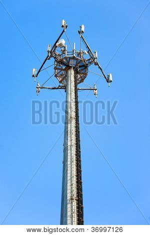 Telecommunications Tower. Mobile Phone Station On A Blue Sky