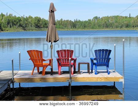 Vibrant Deck Chairs on Lake