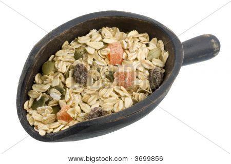 Scoop Of Muesli Cereal With Papaya, Pepitas And Raisins