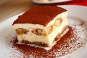 stock photo of dessert plate  - Italian dessert Tiramisu cake on the plate - JPG