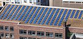 stock photo of solar battery  - solar panels on the roof of administrative building - JPG