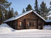 pic of laplander  - Romantic snow covered log cabin between the trees in a holiday resort in Lapland Finland - JPG