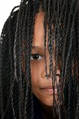 stock photo of cornrow  - closeup young black girl with Cornrows over face - JPG
