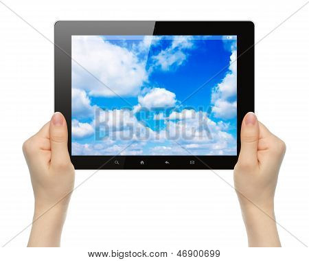 Woman hands holding tablet PC with sky