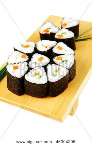 sushi rolls served with steams on wood stand