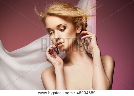 Beautiful woman with necklace and earrings