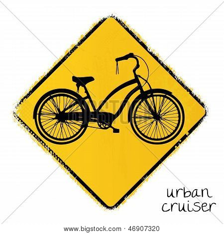warning road sign with a urban cruiser bike