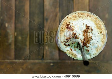 Top view of Ice Coffee on the wooden table