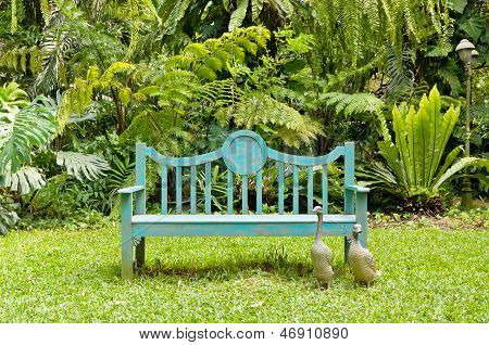 Green bench in the English garden