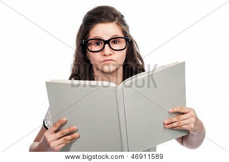 Clever Teenage Girl Reading A Big Book