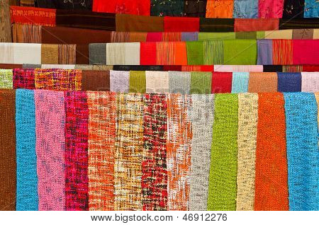 Colorful handmade shawls in loas market