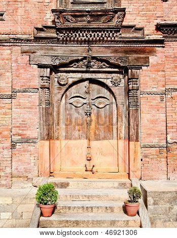 Carved wooden door on Hanuman Dhoka, old Royal Palace, Durbar Square in Kathmandu,  Nepal.