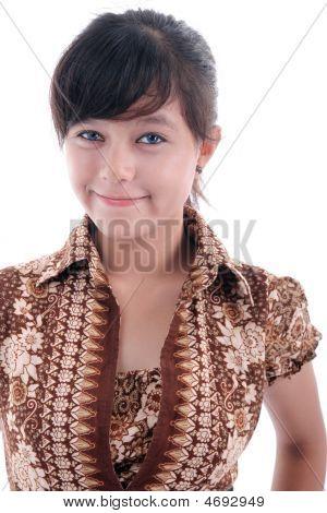 Elagance Cute Young Woman In Batik Dress Smiling