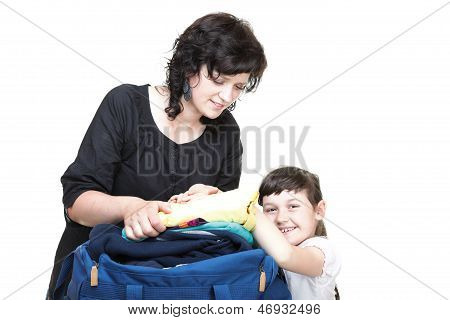 Woman And Daughter Hand Crammed Full Of Clothes And Shoulder Bag Isolated