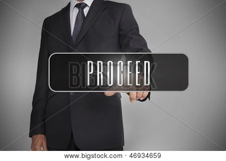 Businessman selecting label with proceed written on it on grey background