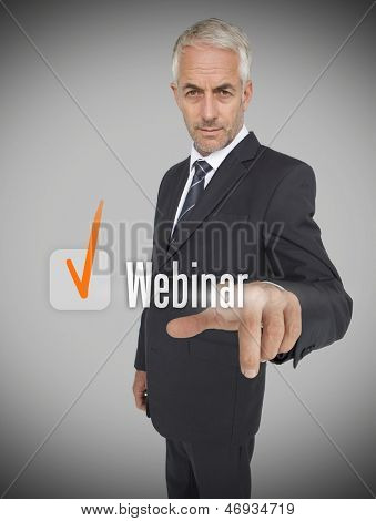 Businessman selecting the word webinar next to a ticked box