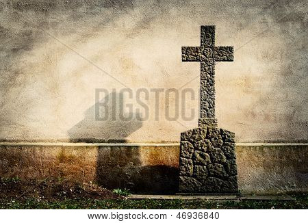 cross on tombstone grunge wall background