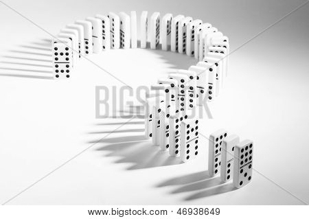 Dominoes In Shape Of Question Mark On Plain Background