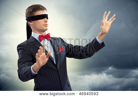 young blindfolded man