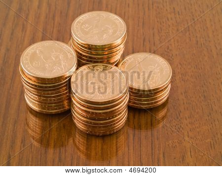 Gold Us Dollar Coins On Wood