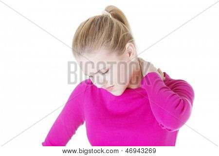 oung woman holding hand on her neck. Neck pain concept .