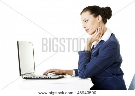 Beautiful brunette businesswoman working on laptop computer isolated on white