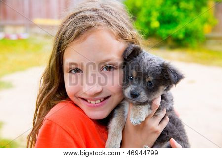 Beautiful kid girl portrait with puppy chihuahua gray dog